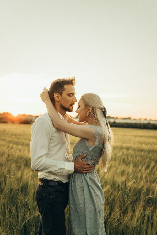 Romantic Couple Standing on a Field