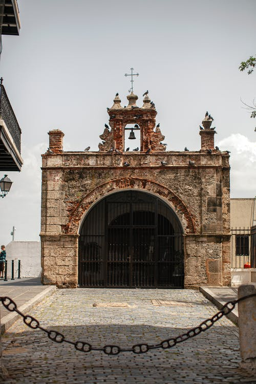 Exterior of folklore historic Catholic Chapel of Christ the Savior built in Baroque style in San Juan on clear summer day
