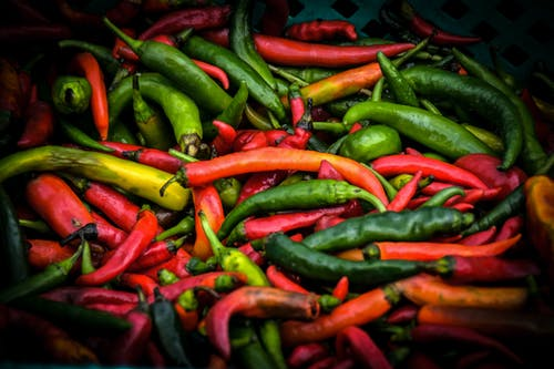 Pile of Green and Red Chilis