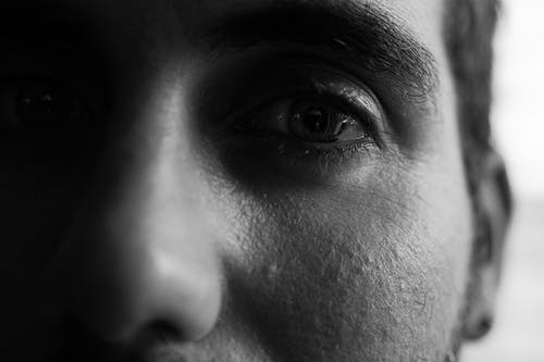 Grayscale Photo of Persons Eyes