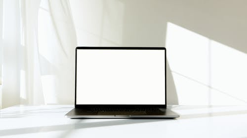 Black and Silver Laptop Computer on White Table