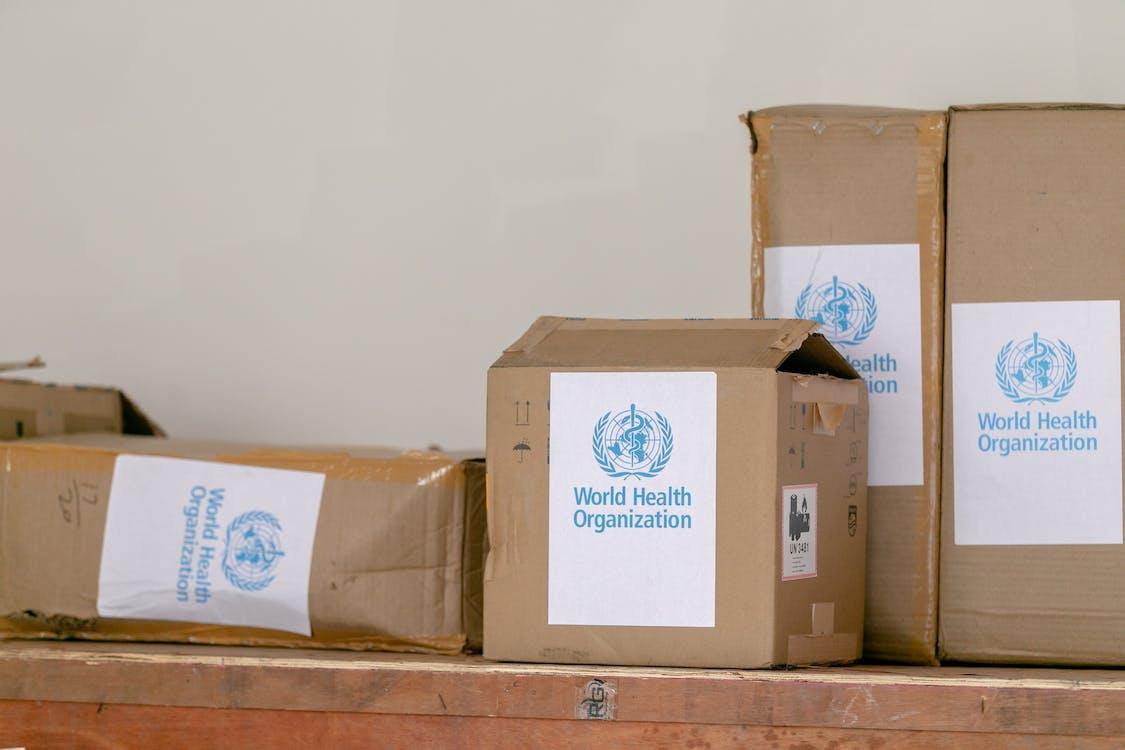 Cardboard boxes with World Health Organization sticker