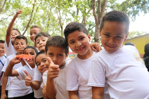 Group of Children Wearing White Crew Neck T-shirts