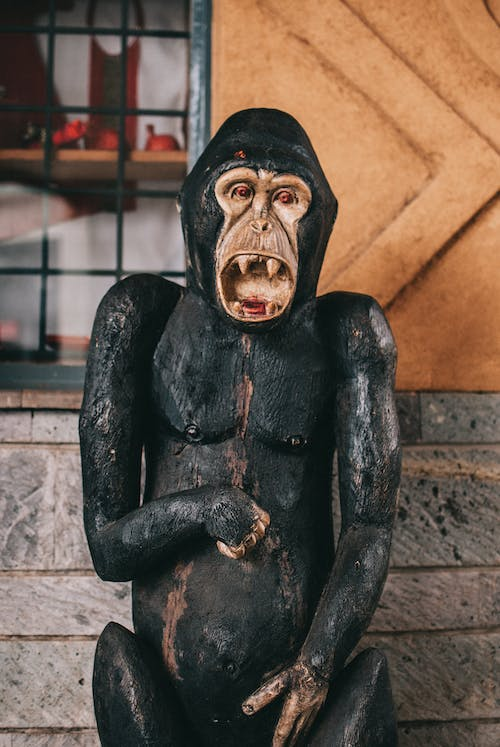Black and Gold Human Face Figurine