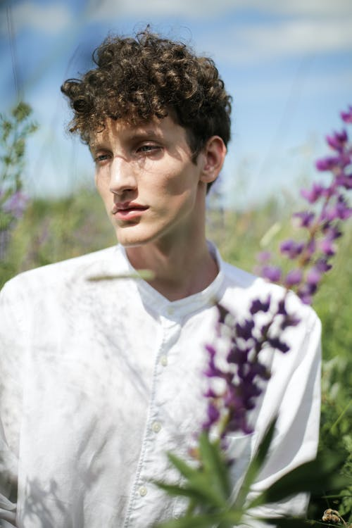Man in White and Purple Floral Shirt