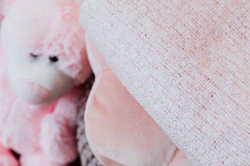 Pink Bear Plush Toy on Pink Textile
