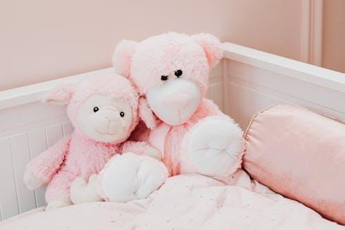 Pink Bear Plush Toy on White Bed