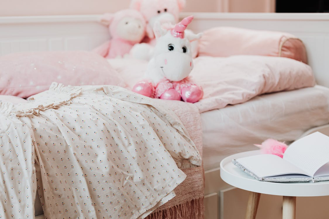 Pink and White Plush Toys on Bed