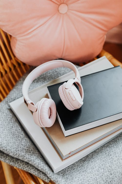 White Beats by Dr Dre Headphones on Gray Book