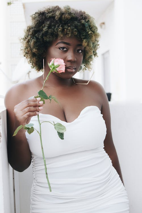 Woman in White Tube Top Holding Green Plant