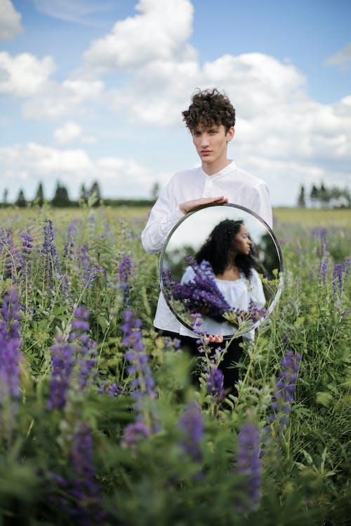 Man in White Dress Shirt Standing on Purple Flower Field