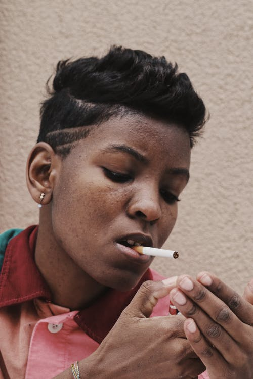 Ethnic woman with cigarette in mouth