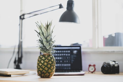 Pineapple Fruit on Brown Wooden Table