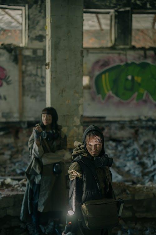 Woman in Black Coat Standing Beside Woman in Black Coat
