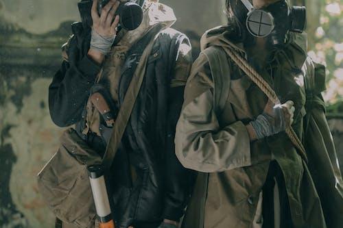 2 Men in Black Jacket and White Helmet