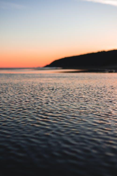 Photos gratuites de aube, bord de mer, ciel