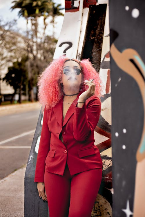 Confident woman in business suit smoking