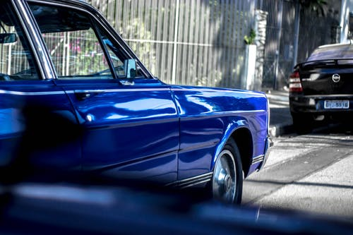 Retro blue car parked on roadside