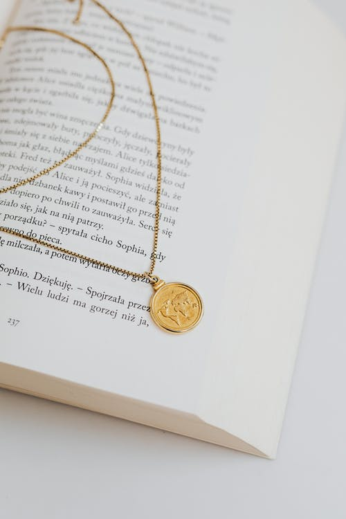 Gold Round Coin on White Printer Paper