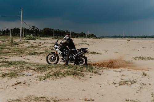 Black Motorcycle on Brown Sand