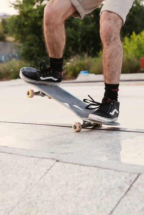 Man Riding Skateboard