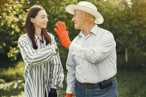Grandfather and Granddaughter Giving Each Other a High Five