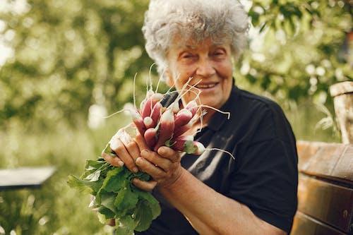 Woman Holding Radish