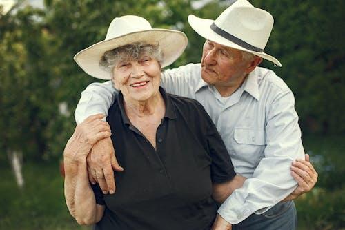 Man in Black Polo Shirt Wearing White Cowboy Hat