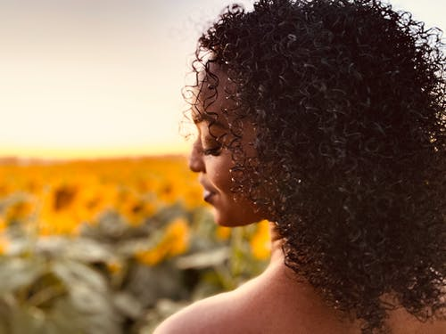 Back View of a Woman with Curly Black Hair