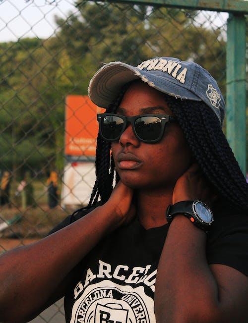 Kostenloses Stock Foto zu afroamerikaner-frau, aussehen, barriere