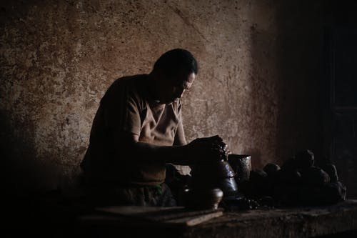 An Artisan Making Clay Pottery