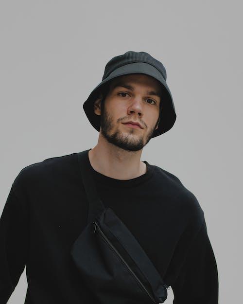Bearded young man looking at camera