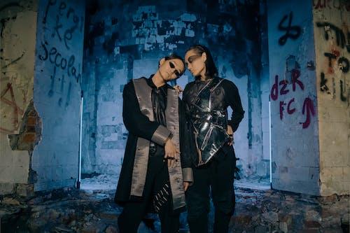 Man in Black Leather Jacket Standing Beside Woman in Black Leather Jacket
