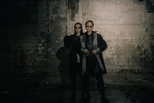 Man in Black Coat Standing Beside Woman in Black Coat