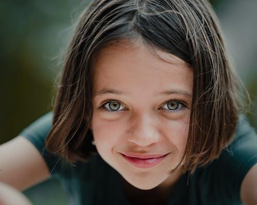 Happy child cheerfully looking at camera