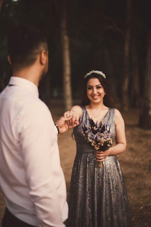 Happy bride holding hand of groom