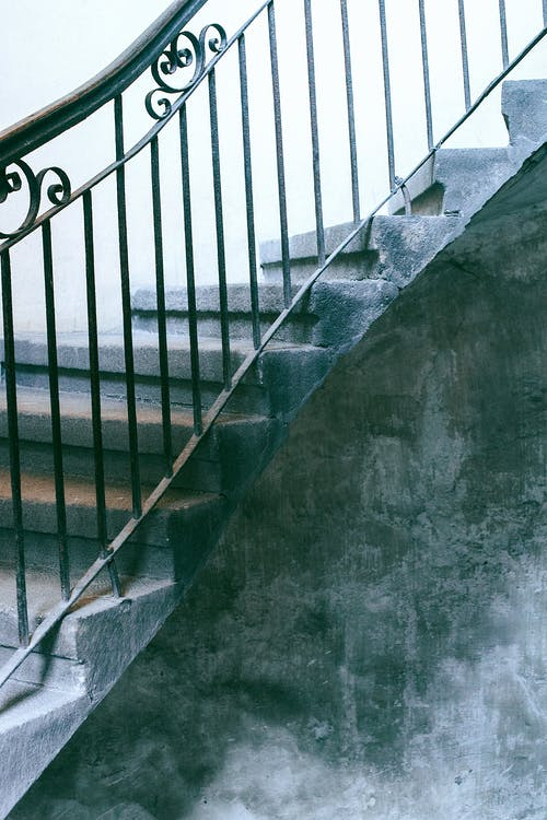 Staircase with railings in shabby porch