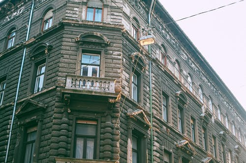 Facade of old residential building in city