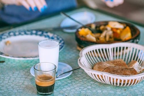 Delicious food with coffee and milk in glasses