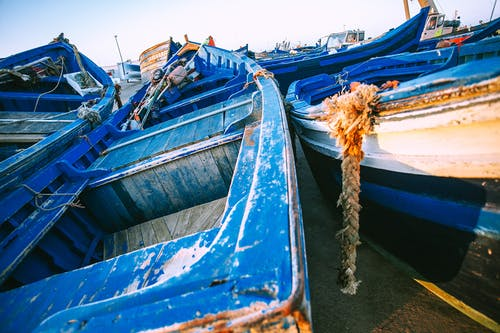 Shabby boats on coast of sea