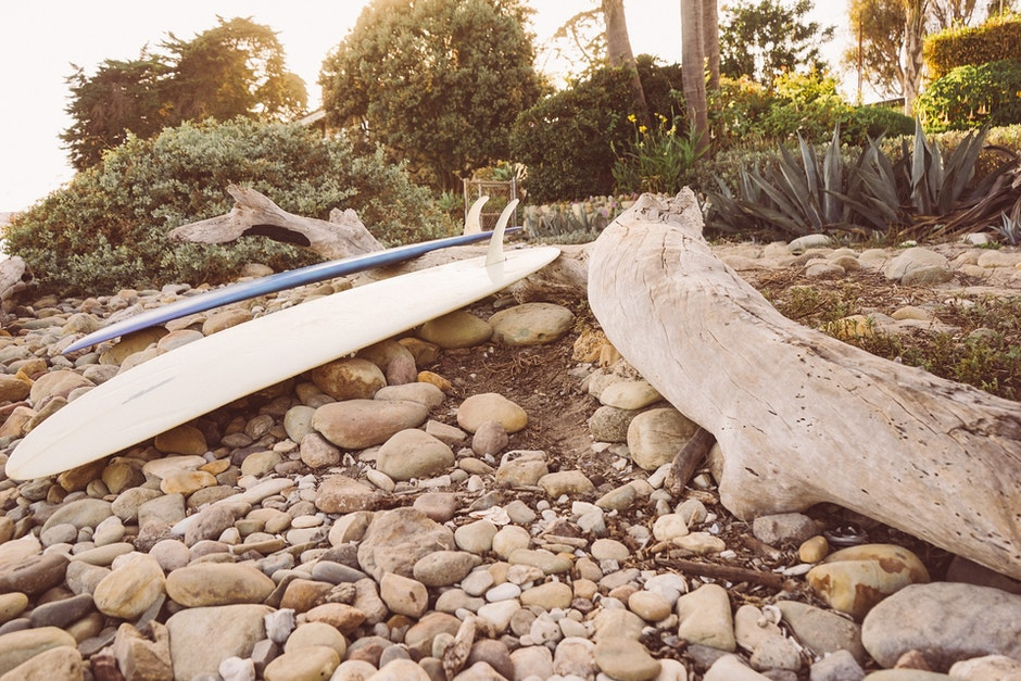 stones, surfboard, surfer