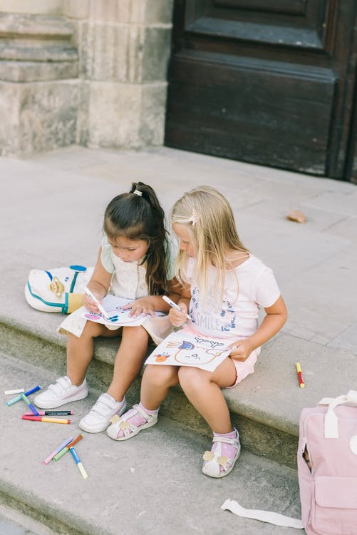Girls Drawing on Steps
