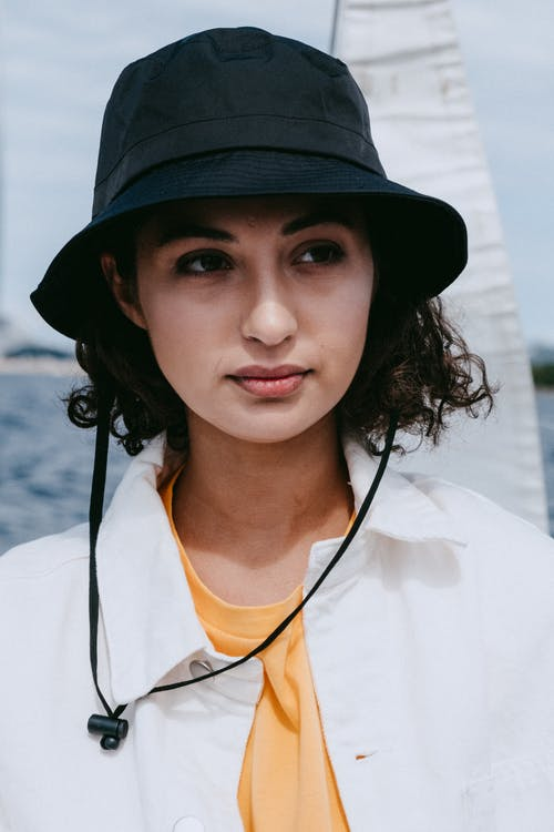 Woman in Black Fedora Hat and White Crew Neck Shirt