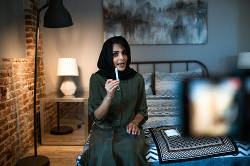 Woman in a Hijab Holding a Tampon