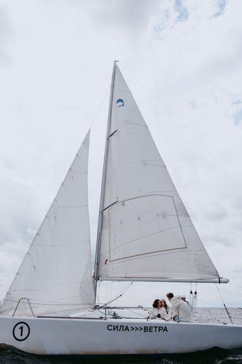White Sail Boat on Water