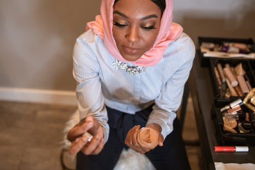 Woman in White Long Sleeve Shirt Wearing Pink Hijab