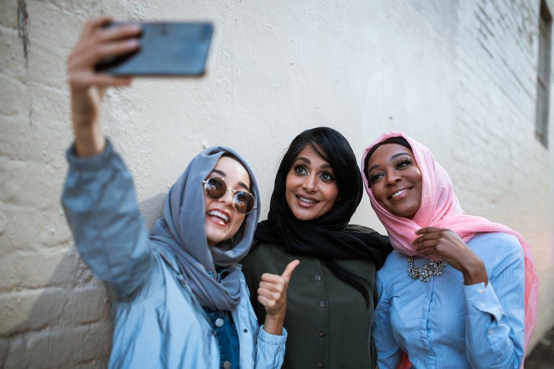 3 Women Wearing Hijab Taking a Selfie