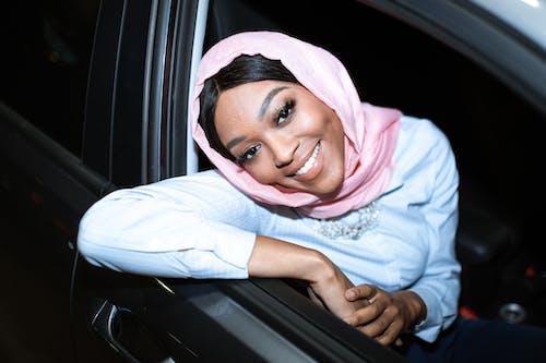 Woman in Pink Hijab Sitting on Car Seat