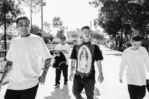 Group of Asian men walking on street