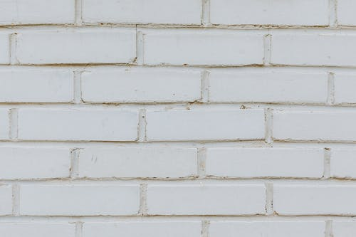 White brick wall of stone building